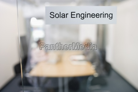 two people in a solar engineering