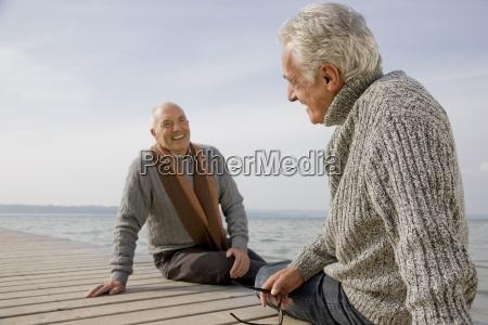 two senior men sitting on a