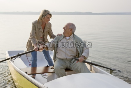 a senior couple rowing on a