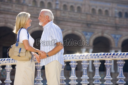 senior couple hand in hand on
