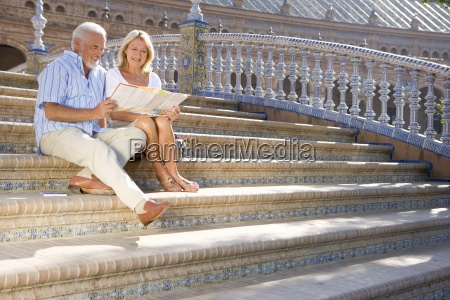 senior couple looking at tourist map