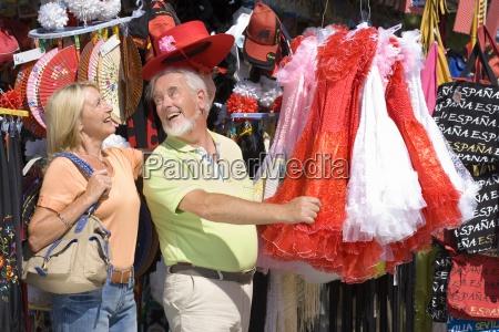 senior couple shopping man in hat