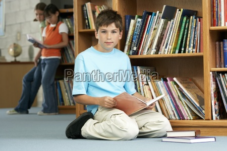 boy 10 12 kneeling on floor