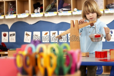 multi coloured scissors in classroom focus
