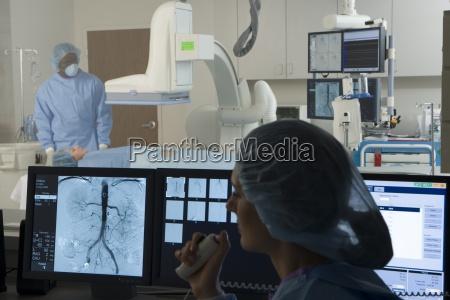 doctors scanning patient in hospital focus