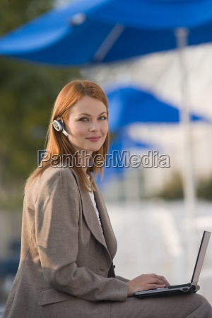 businesswoman with mobile phone hands free