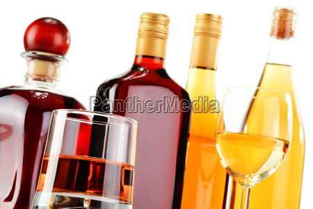 bottles and glasses of assorted alcoholic