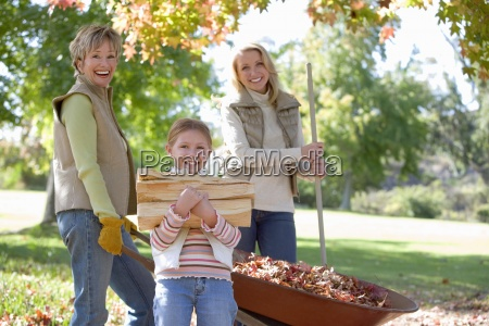 girl 7 9 holding firewood in