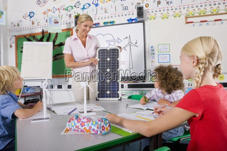 teacher explaining solar panel to students