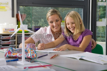 teacher helping student study about wind
