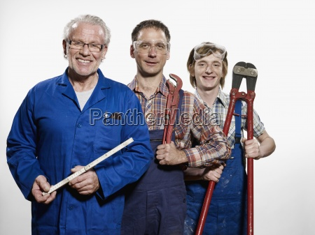 portrait three people mixed age carpentry