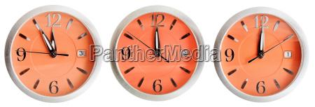 set of orange clock faces with