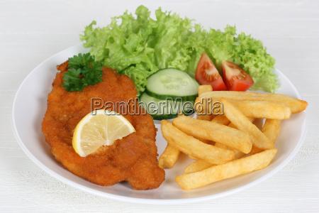 wiener schnitzel dish with fries salad