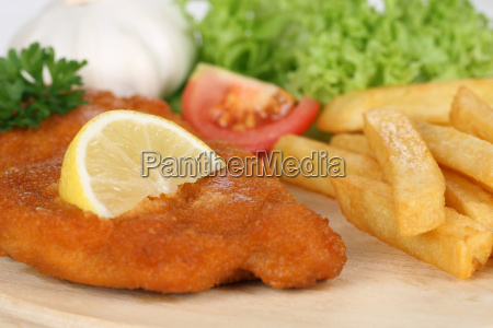 breaded schnitzel dish with fries lemon