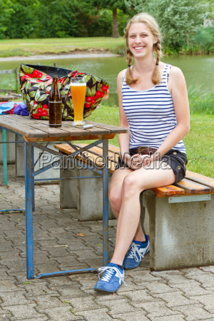 young woman with beer in the