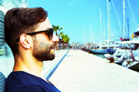 young man at the harbor in