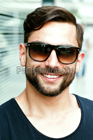 young attractive man wearing sunglasses