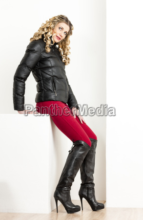 sitting woman wearing fashionable clothes with