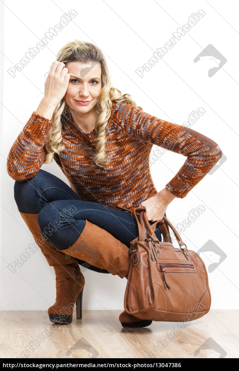 sitting, woman, wearing, fashionable, brown, boots - 13047386