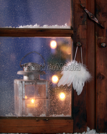 feathers hanging on window pane for