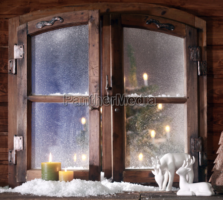 snow reindeer and lighted candles at