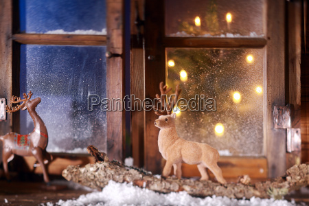 reindeer decors for christmas at window