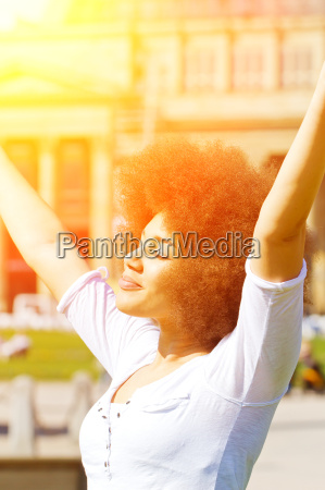 happy young woman with afro hairstyle
