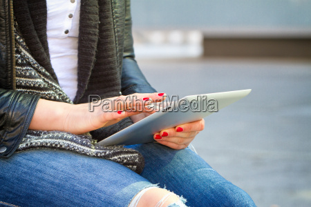 young modern woman with tablet
