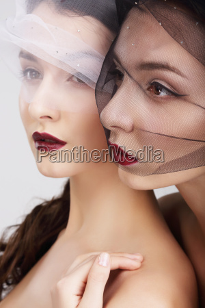 fondness two females in veils embracing