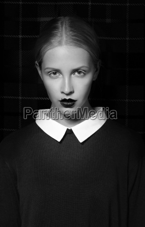 studio portrait of strict woman with