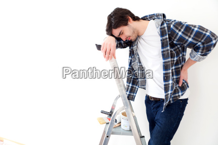 young man suffering while working on