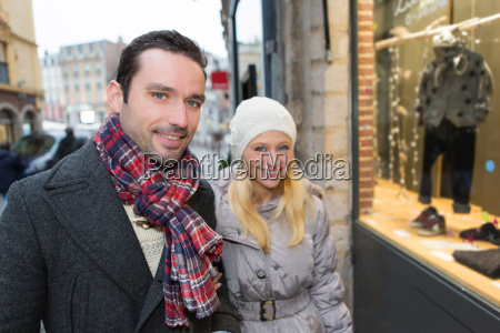 young attractive couple doing some window
