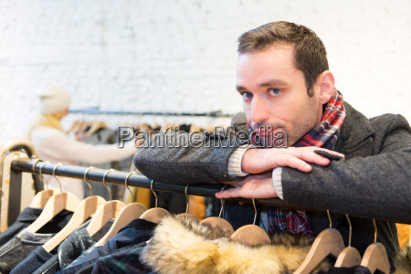 young casual man waiting while his