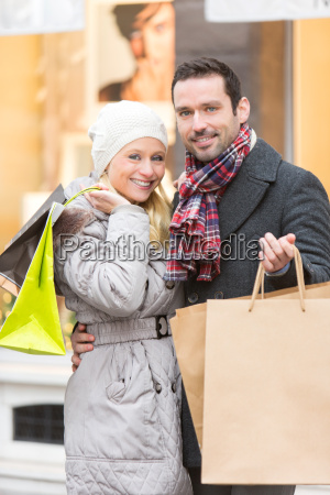 young attractive couple with shopping bags