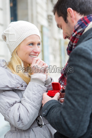young attractive man propose marriage to