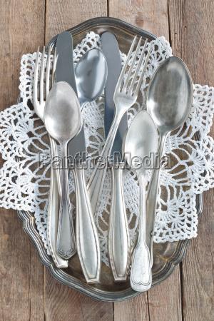 cutlery on silver platter