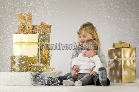 children with christmas parcels