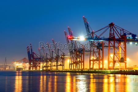 container cranes in hamburg harbor