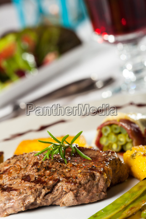 steak with rosemary