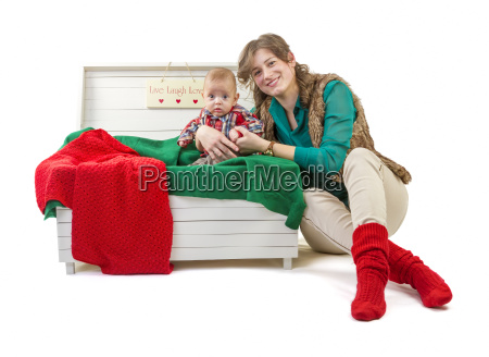 baby boy in old box with