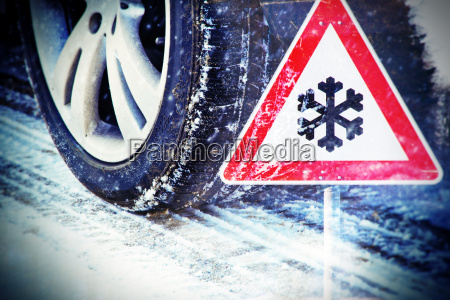 winter tires with road sign