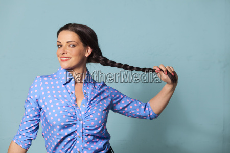 smiling woman with a plait