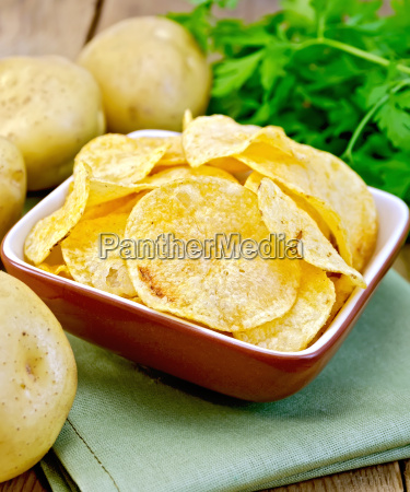 chips in bowl with potato on