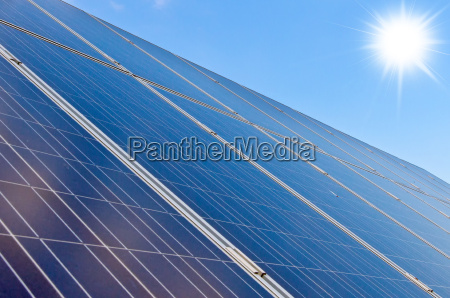 roof with solar panels and sun