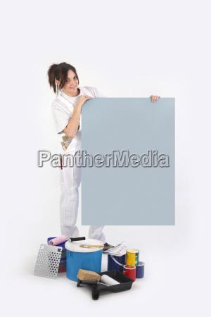 painter holding blank board