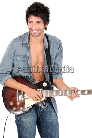 young man playing on his electric