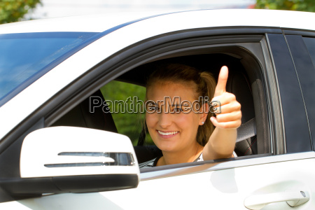 motorist with thumbs up