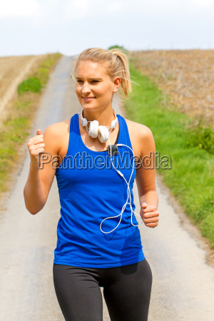 young woman jogging with mp3 player