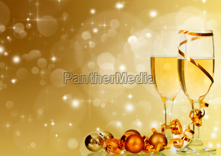 glasses with champagne and christmas decoration