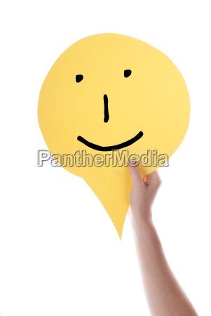 yellow speech balloon with a smiley